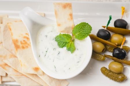 fresh Greek Tzatziki yogurt dip and pita bread and pickels Stock Photo - 17846715