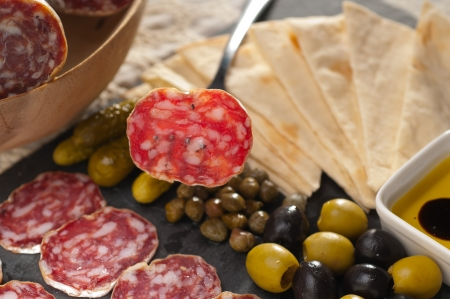 fresh cold cut platter with pita bread and pickles antipasti photo