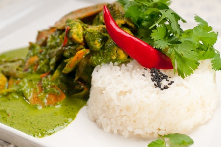 chicken with green curry fresh vegetables and rice photo