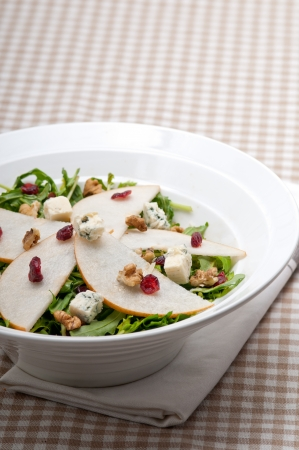 Fresh pears arugula gorgonzola cheese salad with cranberry and walnuts Stock Photo - 18399610