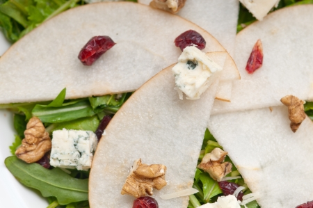 Fresh pears arugula gorgonzola cheese salad with cranberry and walnuts Stock Photo - 18399604