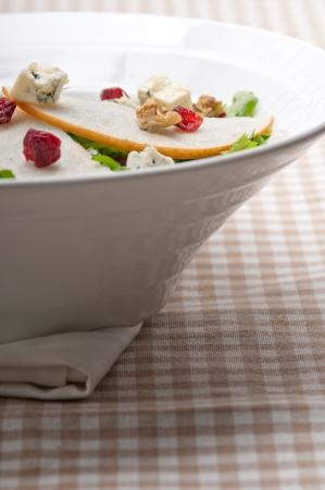 Fresh pears arugula gorgonzola cheese salad with cranberry and walnuts Stock Photo - 18399615