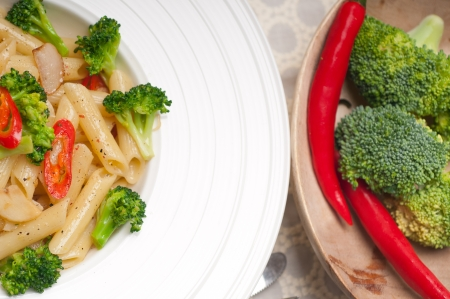 classic Italian penne pasta with broccoli and red chili pepper Stock Photo - 18399605