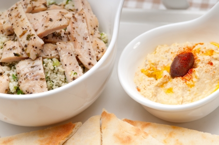 fresh traditional arab chicken taboulii couscous with hummus Stock Photo - 18399612