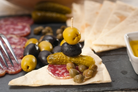 fresh cold cut platter with pita bread and pickles antipasti Stock Photo - 18511595