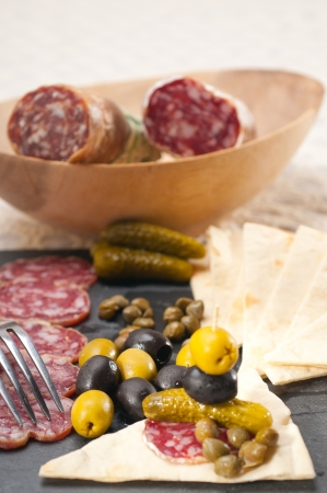 fresh cold cut platter with pita bread and pickles antipasti Stock Photo - 18511588
