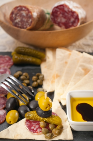 fresh cold cut platter with pita bread and pickles antipasti Stock Photo - 18511596