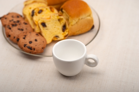 selection of sweet bread and cookies for breakfast with empty coffee cup on side Stock Photo - 18511563