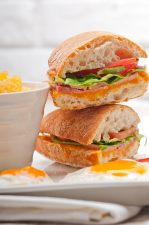 fresh ciabatta panini sandwich with eggs tomato lettuce Stock Photo - 18511598