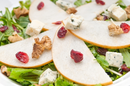 Fresh pears arugula gorgonzola cheese salad with cranberry and walnuts Stock Photo - 18511640