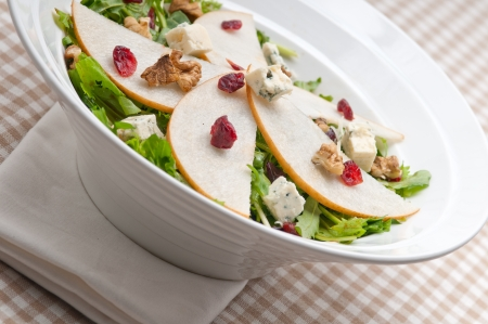 Fresh pears arugula gorgonzola cheese salad with cranberry and walnuts Stock Photo - 18511634