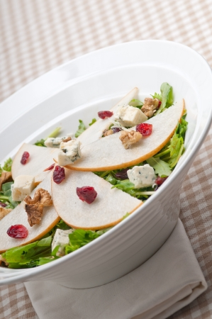 Fresh pears arugula gorgonzola cheese salad with cranberry and walnuts Stock Photo - 18511641