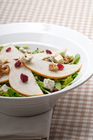 Fresh pears arugula gorgonzola cheese salad with cranberry and walnuts Stock Photo - 18511633