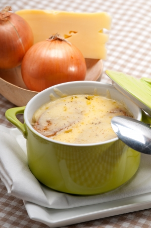 onion soup on clay pot with melted cheese and bread on top Stock Photo - 18511635