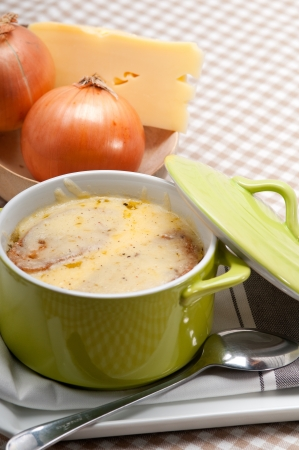 onion soup on clay pot with melted cheese and bread on top Stock Photo - 18511630
