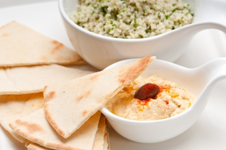 fresh traditional arab taboulii couscous with hummus photo