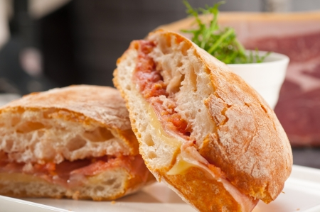 Italian ciabatta panini sandwich with parma ham and tomato 스톡 사진