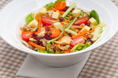Fresh mixed colorful healthy salad closeup vegetarian food photo