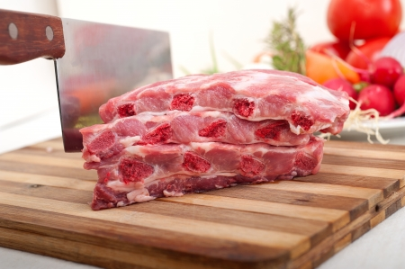 chopping fresh pork ribs with vegetables and herbs ready to cook Stock Photo - 19016816