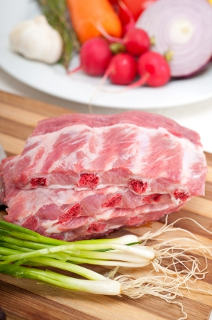 chopping fresh pork ribs with vegetables and herbs ready to cook Stock Photo - 19016812