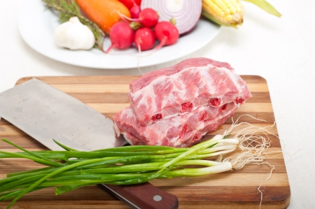 chopping fresh pork ribs with vegetables and herbs ready to cook Stock Photo - 19016809
