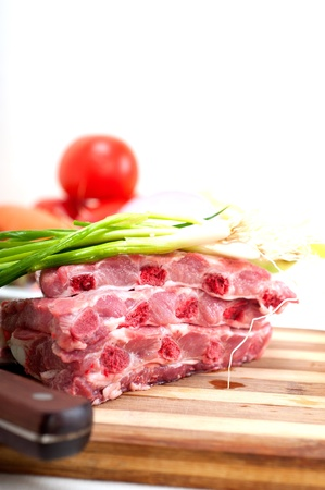 chopping fresh pork ribs with vegetables and herbs ready to cook Stock Photo - 19016824