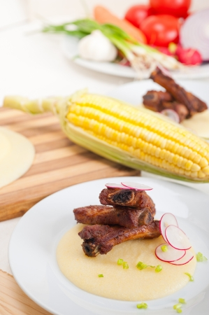 traditional Italian roasted pork ribbs served on polenta bed,corn cream Stock Photo - 19016802