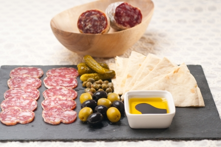 fresh cold cut platter with pita bread and pickles antipasti Stock Photo - 19016853