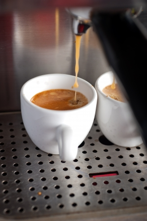 Italian espresso coffe making with professional machine macro  Stock Photo - 19128497