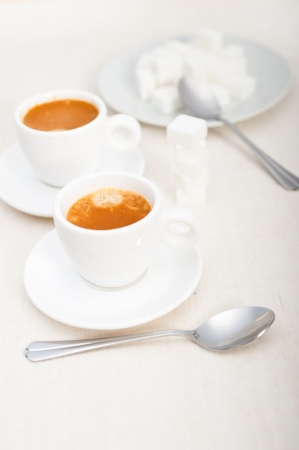 Italian espresso coffee fresh brewed macro closeup with sugar cubes Stock Photo - 19128480