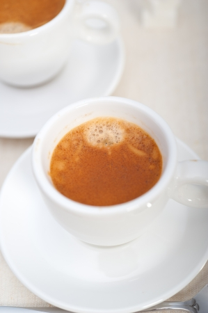 Italian espresso coffee fresh brewed macro closeup with sugar cubes Stock Photo - 19128489