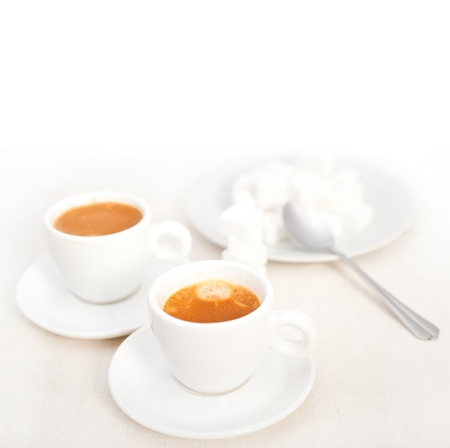 Italian espresso coffee fresh brewed macro closeup with sugar cubes Stock Photo - 19128479