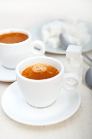 Italian espresso coffee fresh brewed macro closeup with sugar cubes Stock Photo - 19128482
