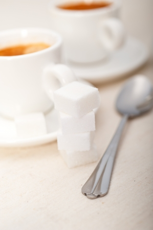 Italian espresso coffee fresh brewed macro closeup with sugar cubes Stock Photo - 19128490