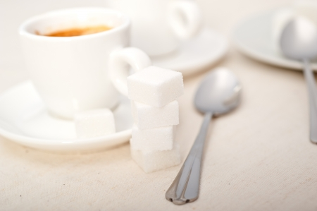 Italian espresso coffee fresh brewed macro closeup with sugar cubes Stock Photo - 19128485