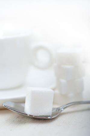 Italian espresso coffee fresh brewed macro closeup with sugar cubes Stock Photo - 19128481
