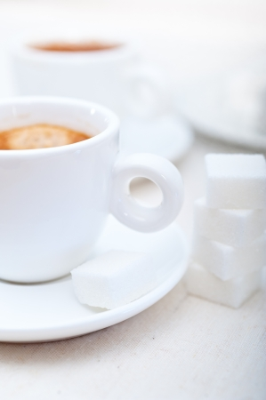 Italian espresso coffee fresh brewed macro closeup with sugar cubes Stock Photo - 19128484
