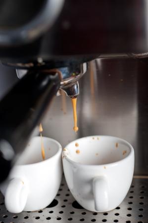Italian espresso coffe making with professional machine macro Stock Photo - 19277478