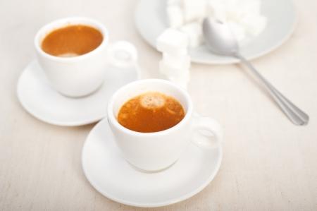 Italian espresso coffee fresh brewed macro closeup with sugar cubes Stock Photo - 19277466