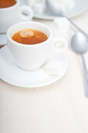 Italian espresso coffee fresh brewed macro closeup with sugar cubes Stock Photo - 19277464