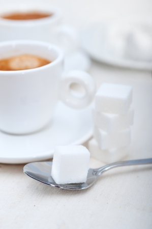 Italian espresso coffee fresh brewed macro closeup with sugar cubes Stock Photo - 19277471
