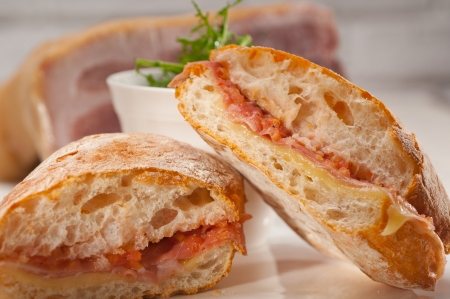 Italian ciabatta panini sandwich with parma ham and tomato Stock Photo - 19277512