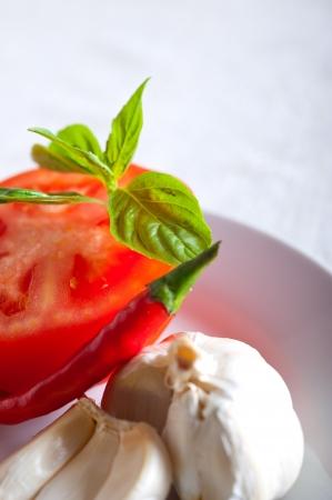 Italian spaghetti pasta tomato raw  ingredients basil garlic and red chili pepper Stock Photo - 19277472