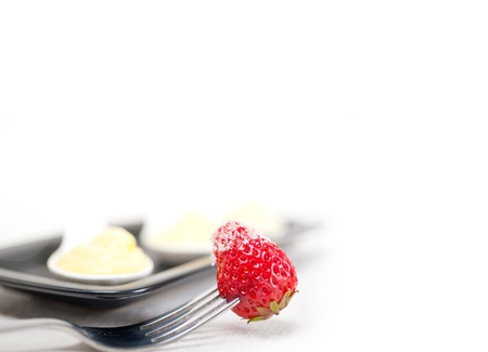 custard pastry cream and strawberry on a fork photo
