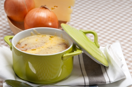 onion soup on clay pot with melted cheese and bread on top Stock Photo - 19277559