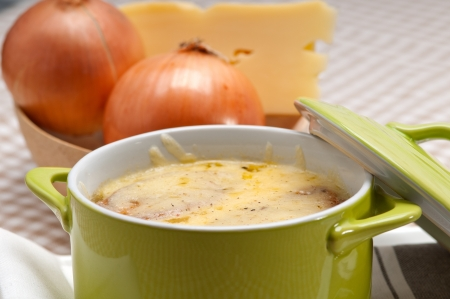 onion soup on clay pot with melted cheese and bread on top Stock Photo - 19277556