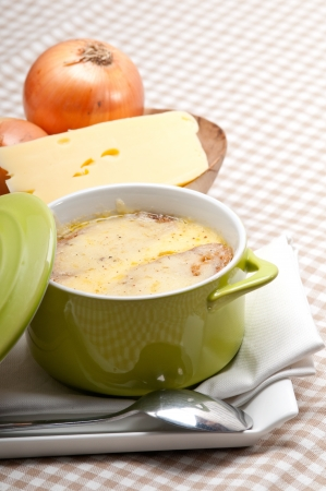 onion soup on clay pot with melted cheese and bread on top Stock Photo - 19277552