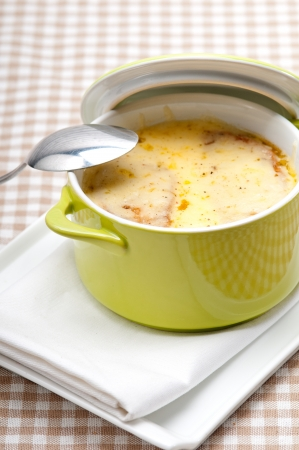 onion soup on clay pot with melted cheese and bread on top Stock Photo - 19413073