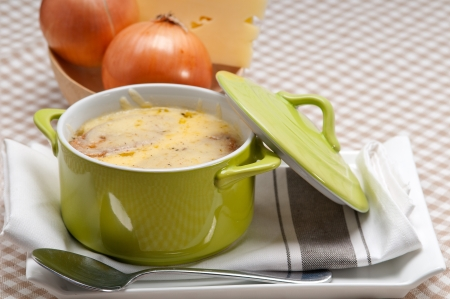 onion soup on clay pot with melted cheese and bread on top Stock Photo - 19413077