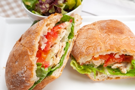 ham sandwich: italian ciabatta panini sandwich with chicken and tomato Stock Photo